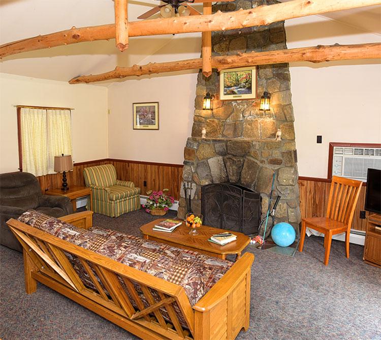 Adirondack Lodge fireplace and futon