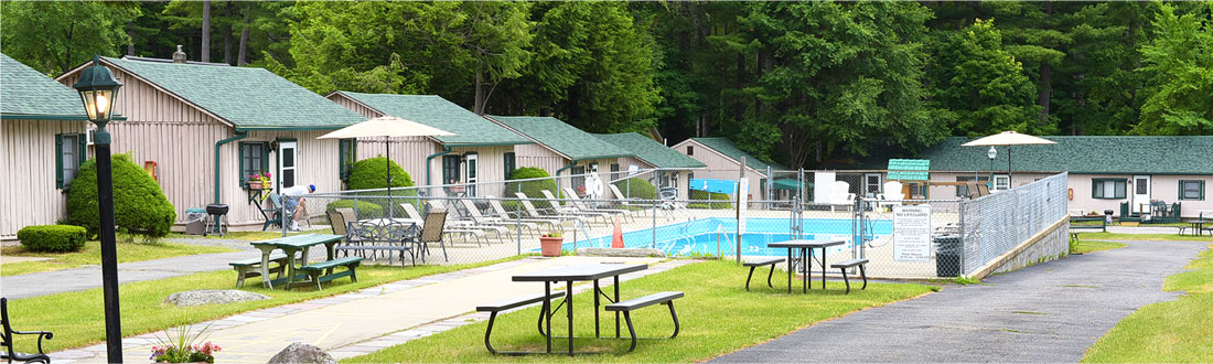 Pool and cabins with picnic tables