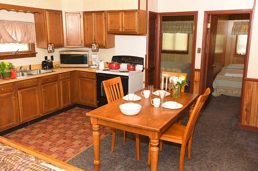 Adirondack Lodge Kitchen with dining area, full range, and microwave
