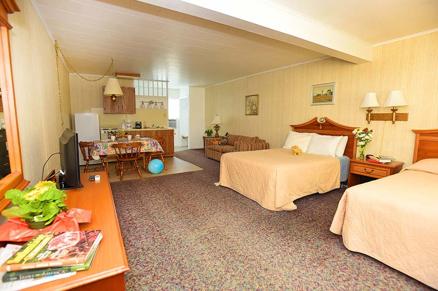 Motel Suite with two double beds and a pull-out couch